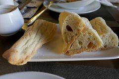Georgian home of sliced bread on the plate. Sliced Georgian homemade bread on a plate in a small restaurant royalty free stock photography