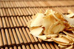 Sliced ginseng. Close up of sliced ginseng a ingredient used in Traditional Chinese Medicine Stock Photos