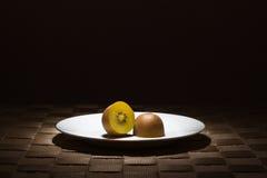 Sliced golden flesh kiwi Royalty Free Stock Images