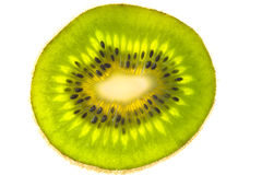 A sliced golden kiwifruit. One green ringed natural kiwifruits Stock Photo