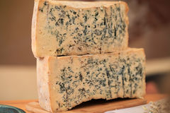 Sliced Gorgonzola or Roquefort cheese loaf Stock Photos