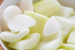 Sliced gourd and radish in a white bowl. Closeup sliced gourd and radish in a white bowl Stock Photos