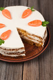 Sliced gourmet carrot sponge cake with icing cream Stock Photos