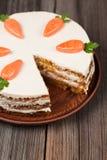 Sliced gourmet carrot sponge cake with icing cream Stock Photos