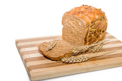 Sliced grain bread with ears Royalty Free Stock Photography