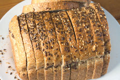 Sliced grain bread on white plate top view Royalty Free Stock Photography