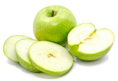 Apple Granny Smith. Sliced Granny Smith apples, one whole apple, one half and circles, isolated on white backgroundn Stock Photo