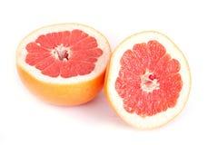 Sliced grapefruit. Ripe sliced grapefruit isolated on white background royalty free stock photo