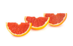 Sliced Grapefruit. Over white background Royalty Free Stock Photos