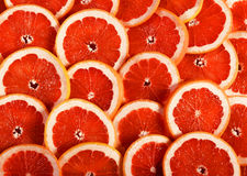 Sliced grapefruit as a background. Royalty Free Stock Images