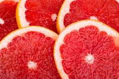 Sliced grapefruit. Background of sliced and folded pieces of grapefruit Royalty Free Stock Photography