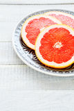Sliced grapefruit on a plate Royalty Free Stock Photos