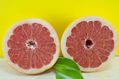 Sliced grapefruit on a table Royalty Free Stock Images