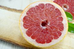 Sliced grapefruit on a wooden board Royalty Free Stock Photos