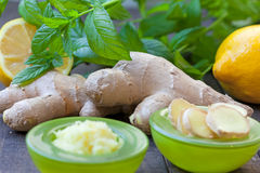 Sliced and grated ginger root. With lemon and mint Stock Photos