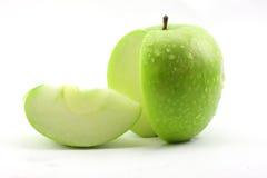 The sliced green apple stock photos