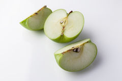 Sliced green apple from high angle on white Royalty Free Stock Image