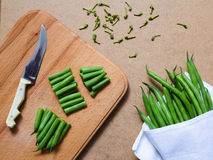 Sliced green beans  and a bunch of green beans on the table Stock Photo
