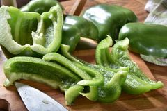 Sliced Green Bell Peppers. Fresh sliced green bell peppers on a cutting board Royalty Free Stock Photo