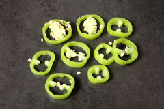 Sliced green bell peppers on the table Royalty Free Stock Photos