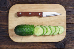 Sliced green cucumber and knife Stock Photography