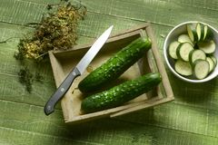 Sliced green cucumber on wooden table Stock Images