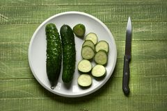 Sliced green cucumber on wooden table Stock Photography