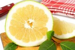Sliced green grapefruit Royalty Free Stock Photo