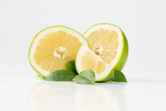 Sliced green grapefruit Royalty Free Stock Images