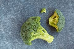 Sliced green raw broccoli, a healthy ingredient for vegan food. Top view Royalty Free Stock Photography
