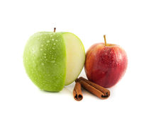 Sliced green and red apple (cinnamon). Sliced green and red apple with cinnamon pods (white background). Fresh diet fruit (water drops). Healthy fruit with Royalty Free Stock Photography