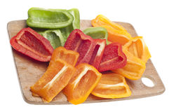 Sliced Green, Red and Orange Bell Peppers Stock Photography