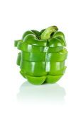 Sliced green sweet pepper. Isolated on the white background Stock Images