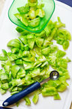 Sliced green tomatoes. Slicing green tomatoes for jam Stock Photo