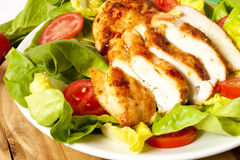 Chicken slices with salad Royalty Free Stock Images