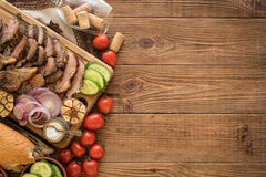Sliced grilled meat barbecue on cutting board. stock image