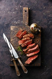 Sliced grilled steak with knife and fork Stock Photo