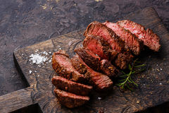 Sliced grilled steak and rosemary Royalty Free Stock Photos