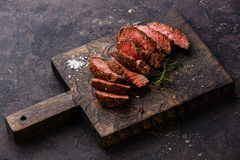 Sliced grilled steak and rosemary Royalty Free Stock Photo