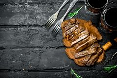 Sliced grilled steak with wine stock photo