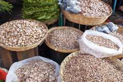 Betel Nuts at Market. Sliced, halved and chipped betel nuts for sale at a local market in Mawlamyine in southern Myanmar Stock Images