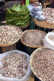 Betel Nuts at Market. Sliced, halved and chipped betel nuts for sale at a local market in Mawlamyine in southern Myanmar Stock Image