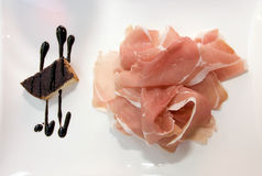 Sliced ham. Sliced fet ham on a white background Stock Images