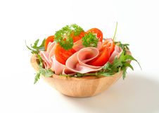 Sliced ham with arugula and tomatoes Stock Images