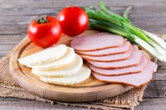 Sliced ham and cheese on a cutting board Royalty Free Stock Photo