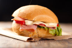 Sliced ham and cheese sandwich. Sliced ham sandwich with tomatos on a bun Royalty Free Stock Photography