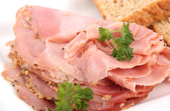 Sliced ham close-up. On plate stock image