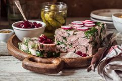 Ham Hock Terrine. Sliced Ham Hock Jelly Terrine with Pickles and Cranberry Sauce stock images