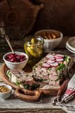 Ham Hock Terrine. Sliced Ham Hock Jelly Terrine with Pickles and Cranberry Sauce, copy space for your text stock photos