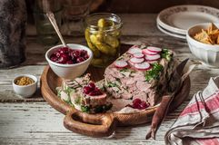 Ham Hock Terrine. Sliced Ham Hock Jelly Terrine with Pickles and Cranberry Sauce royalty free stock photography